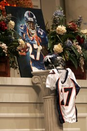 A portrait of slain Denver Broncos cornerback Darrent Williams and his jersey are displayed at his funeral service. The funeral was held Saturday in Fort Worth, Texas.
