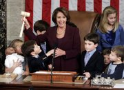 Newly elected Speaker of the House Nancy Pelosi holds up the gavel while surrounded by children and grandchildren of members of Congress on Thursday at the U.S. Capitol. Pelosi and fellow Democrats have taken the reins of Congress.