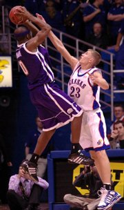Former jayhawk micah downs, right, defends Western Illinois' Marlon Mahorn. Downs could see his first action this weekend since transferring to Gonzaga.
