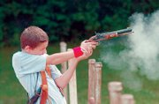 Brandon Meyers, 12, fires a muzzleloader at a target at the Fraternal Order of Police lodge near Lone Star Lake. Some neighbors are upset by the noise coming from the shooting range at the FOP lodge, which is used by law enforcement agencies and other events, such as the Washington Creek Muzzleloader shooting competition.