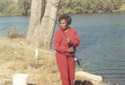 Alice Frye pulls a fish out of a favorite family fishing spot on the Kansas River in this 1988 photo. Frye, who was severely burned in a kitchen fire on Sunday, has died of her injuries.