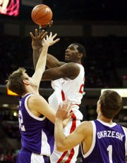 Ohio State's greg oden, right, shoots over Northwestern's Vince Scott on Wednesday.