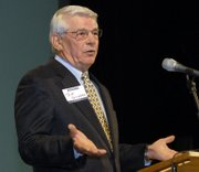 Tom Groene, retired from CEK Insurance, speaks at the Lawrence Chamber of Commerce annual meeting and awards program after receiving the Citizen of the Years award. The annual meeting and awards were given out Friday night at Liberty Hall.