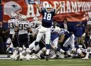 Indianapolis quarterback Peyton Manning celebrates Joseph Addai's go-ahead touchdown run. The Colts defeated the Patriots, 38-34, Sunday in Indianapolis.