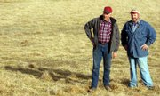 Ralph Kitsmiller, left, and Roger Kitsmiller operate land for the Kansas Bankers Association Buffer Award winners, Steve Crawford and his wife, Bonnie, and Laurel Holladay, who is Steve's aunt. The Kitsmillers sowed the lands with native grasses, qualifying the winners for the awards.