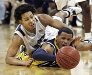marquette's dominic james, right, reaches for a loose ball with Pittsburgh's Ronald Ramon in the second half of a Top-25 matchup. Marquette beat Pittsburgh, 77-74, in overtime Sunday in Pittsburgh.