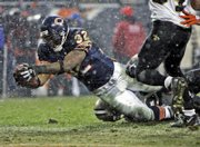 Chicago's Cedric Benson dives into the end zone.