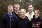 The Crawfords, from left, Wes, 19, John, 21, Bonnie, Steve and Stephanie, 16, are shown at their land east of Lawrence. Steve and Bonnie Crawford have received a Buffer Award from the Kansas Bankers Association, as has Steve's aunt, Laurel Holladay, for work on her adjacent property.