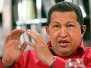 "Venezuelan President Hugo Chavez speaks during his weekly television show ""Hello President"" on Sunday in Caracas. Chavez condemned the U.S. government for what he called unacceptable meddling after Washington raised concerns about a measure to grant Chavez broad lawmaking powers."