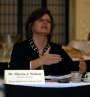 MarciA Nielsen, who works for the Kansas Health Policy Authority, participates in the first day of a two-day retreat in Lawrence. The board is working to set a statewide health agenda.