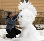 Most of Lawrence probably sat in on Sunday but not Craig Cochran who lives at 328 Elm in north Lawrence. Sunday Cochran got up and took to the snow creating a punk rocker in his front yard. Monday Cochran did alittle touch up work as temperatures cooled off for some more detail.