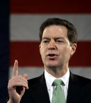 "Sen. Sam Brownback, R-Kan., announces his intention to run for president Saturday in Topeka. On Monday, Brownback participated in an anti-abortion march in Washington, D.C., where marchers carried ""Brownback for President"" signs."