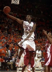Auburn's Korvotney Barber (32) puts up a shot against Alabama. Barber led Auburn with 18 points in its 81-57 victory against No. 12 Alabama on Tuesday in Auburn, Ala.