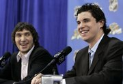 The Washington CAPITALS' Alex Ovechkin, RIGHT, and the PITTSBURGH PENGUINS' SIDNEY CROSBY speak during media availability as part of the NHL All-Star Game festivities. The two young stars will play in tonight's All-Star Game in Dallas.