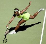 Serena Williams runs down a shot during the Australian Open semifinals. Williams defeated Nicole Vaidisova, 7-6 (5), 6-4, today in Melbourne, Australia.