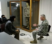 Army Maj. Gen. Carter Ham gives an interview to Japanese television during a State Department sponsored tour of Fort Riley Army Base. About three dozen foreign media representatives took part in the event aimed at dispelling myths and stereotypes about America and to put real people behind U.S. policies abroad.