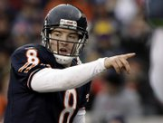 Chicago Bears quarterback Rex Grossman gestures at the line against the Seattle Seahawks in the NFC divisional playoff game Sunday in Chicago. The Indianapolis Colts will face the Bears in Super Bowl XLI on Feb. 4 in Miami.