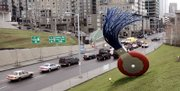"The 19-foot-tall ""Typewriter Eraser, Scale X,"" by Claes Oldenburg and Coosje van Bruggen stands in view of traffic passing on nearby Elliott Avenue at the Seattle Art Museum&squot;s new sculpture park. The museum opened the art park on the downtown waterfront Saturday, bringing a free cultural experience to local residents and telling the world Seattle has something new worth noting."