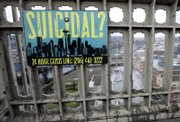 A sign advising of the phone number for a suicide-prevention hot line is shown on the Aurora Bridge in Seattle. The signs, along with telephone call boxes, were put up in December in an effort to reduce the number of people who jump to their deaths from the bridge. Eight people did so in 2006.