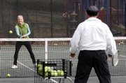 Palafox works with Cam Fenton during a Cardio Tennis workout. Organizers say participants get fitter, faster than with traditional tennis, and the rapid-fire repetition helps hone true tennis skills, too.