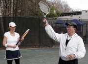Caroline McCrary, left, 42, of Atlanta returns balls to instructor Tony Palafox during a Cardio Tennis workout. The Atlanta YMCA, where McCrary and Palafox worked out, is one of more than 1,500 sites that gives Cardio Tennis classes.