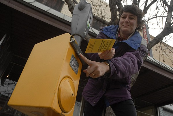 Joan Sereno deposits her parking ticket payment Thursday, Jan. 28, 2007, in the 900 block of Massachusetts Street.