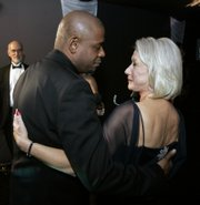 Forest Whitaker and Helen Mirren congratulate each other backstage at the 13th annual Screen Actors Guild Awards on Sunday in Los Angeles.
