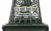 Greenpeace activists display a banner on the Eiffel Tower as scientists from around the world gathered in Paris to finalize a report on climate change. The Intergovernmental Panel on Climate Change is to unveil its latest assessment of the environmental threat posed by global warming Friday.