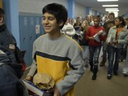 Dravid Joseph, a ninth-grader at West Junior High School, goes about his daily routine Monday at the school, 2700 Harvard Road. On Wednesday he will spend the day in Topeka with state Sen. Marci Francisco as part of Gifted and Talented Day, designed to bring attention to the state's high-performing students.