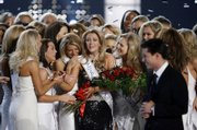 Miss Oklahoma Lauren Nelson, center, is congratulated by her competitors after being crowned Miss America 2007 at the Aladdin Resort & Casino in Las Vegas. Nelson was the second Miss Oklahoma in a row to win the pageant. Host Mario Lopez is at right.