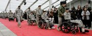 Wounded soldiers arrive for the official dedication of the Center for the Intrepid, a $50 million high-tech rehabilitation center designed to serve the growing number of soldiers who return from war as amputees or with severe burns. The center opened Monday in San Antonio.