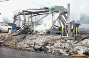 Debris litters the scene of an explosion at a gas station in Ghent, W.Va. Fumes from a leaking propane tank exploded inside the station on Tuesday, shattering the building into a pile of debris and killing at least four people, authorities said.
