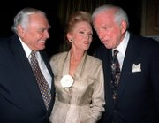 Ernest Borgnine, left, and wife Tova, chat with author Sidney Sheldon at a reception at New York's Le Cirque 2000 restaurant, in this Thursday, Sept. 18, 1998, file photo.  Sheldon, who won awards in three careers before turning to writing best-selling novels, died Tuesday. He was 89.