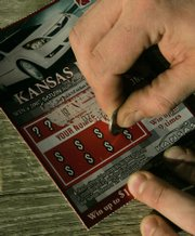 "The Kansas Senate will vote today on a bill to make the lottery a permanent part of state government. The lottery includes several games, including these ""Kansas Made"" scratch-off cards."