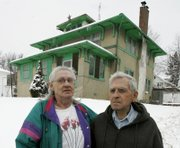 Delores and Ivan Eicher are shown in front of their Omaha, Neb., home. The Eichers were part of a lawsuit with 12 other Omaha area homeowners who alleged that Mid-America Financial Investment Corp. had defrauded them when they thought the company would help them pay their mortgages.