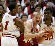 indiana guard armon bassett, left, and Wisconsin's Joe Krabbenhoft battle for a loose ball during the first half. Indiana beat Wisconsin, 71-66, Wednesday in Bloomington, Ind.