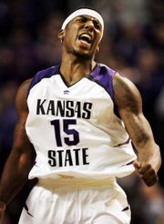 Kansas state forward david hoskins celebrates a basket during the first half against Missouri. K-State beat Missouri, 80-73, Wednesday in Manhattan to improve to 5-2 in the Big 12 Conference.
