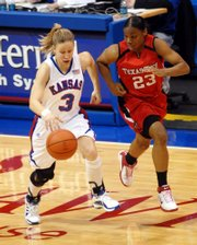 Kansas' Ivana Catic races Texas Tech's Tiny Henderson down court during the first half. Kansas played Texas Tech Wednesday night at Allen Fieldhouse.