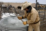 Chopping ice isn't unusual for Gene Packer 71, who lives 9 miles north of Midland Junction, while he chopped ice off some of his watering tanks, Wednesday morning for his cattle as the temperatures were hovering in teens.