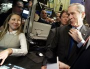 President Bush makes an unannounced visit Wednesday to the New York Stock Exchange and meets trading assistant Jennifer Fagenson at the post that trades the Walt Disney Co. Bush became the second president to visit during trading hours.