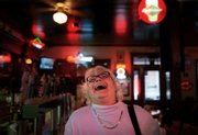 Political columnist Molly Ivins has a laugh during a fundraiser at the ScholzGarten in Austin, Texas, in this Oct. 14, 2002, file photo. Ivins died Wednesday after a long battle with breast cancer. She was 62.