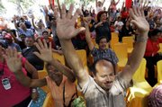 Hundreds of supporters of Venezuela's President Hugo Chavez raise their hands at the Plaza Bolivar in Caracas. They gathered Wednesday as lawmakers read out a bill giving Chavez special powers to enact a wide range of reforms.