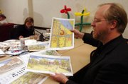 Dill Dennis, design team leader for MFMFM, shows off designs for the city library among other buildings and residential areas around Lawrence on Tuesday afternoon at Spring Hill Suites, 1 Riverfront Plaza. A team of designers has been working on the plans and sketches for the last week.