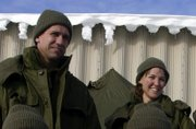 Astronauts William Oefelein, left, and Lisa Nowak are shown on a January 2004 training mission in Quebec, Canada. Nowak was arrested Monday for attempting to kidnap a woman she believed was romantically involved with Oefelein, police said.