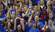 The Kansas student section goes wild after a first half dunk by Sasha Kaun during Wednesday night's game against the Wildcats at Allen Fieldhouse.