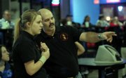 LAWRENCE HIGH JUNIOR BECCA STACK, left, gets some pointers from LHS assistant bowling coach Brian Wyatt during a three-team meet at Royal Crest Lanes. Stack shot a 432 series Tuesday as the Lions finished second behind Olathe Northwest.