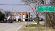 A truck passes through downtown Crawford, Texas, a few miles from President Bush's ranch. The souvenir shops in Bush's hometown have fallen on hard times, in what some say is a gauge of his plummeting popularity.