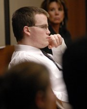 Jason Rose listens to opening statements on the first day of his jury trial in Douglas County District Court.
