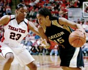 "BAYLOR&squot;S JHASMIN PLAYER drives to the basket against Texas Tech&squot;s LaVonda ""Tiny"" Henderson during the second half. Player scored a career-high 22 points Wednesday night in the Bears&squot; 80-67 victory in Lubbock, Texas."