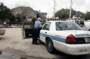 A Houston police officer stands watch outside the Houston home of astronaut Lisa Nowak. Nowak returned Wednesday to Texas and Johnson Space Center for a medical assessment a day after being charged in Florida with trying to murder the woman she believed was her romantic rival for a space shuttle pilot's affections.